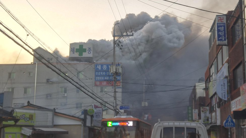 Smoke rises from a burning hospital in Miryang, South Korea