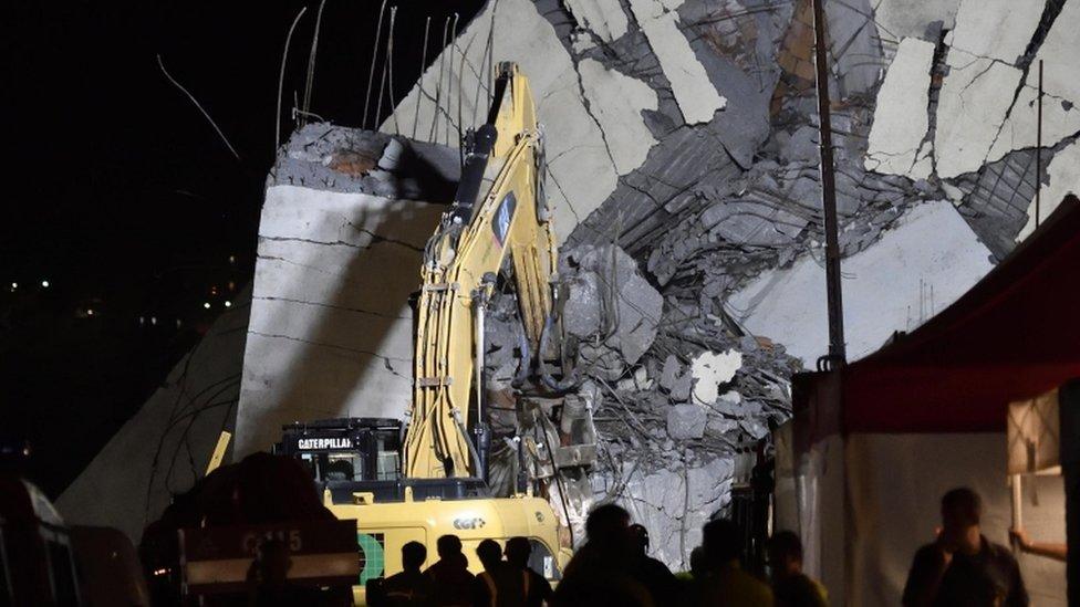 Italy bridge: Bridge rescuers search into the night in Genoa