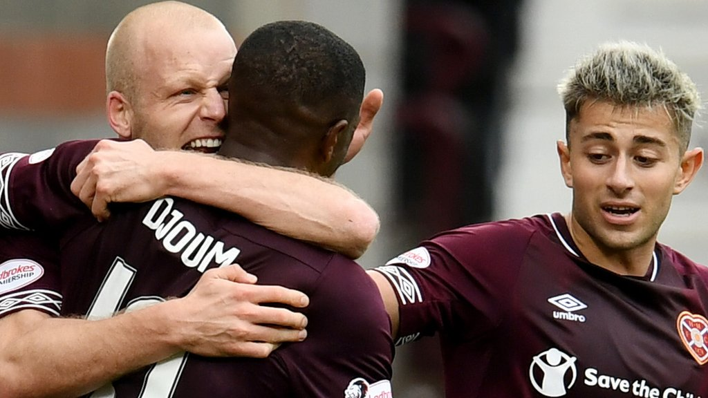 Hearts overcome Aberdeen and adversity to extend lead