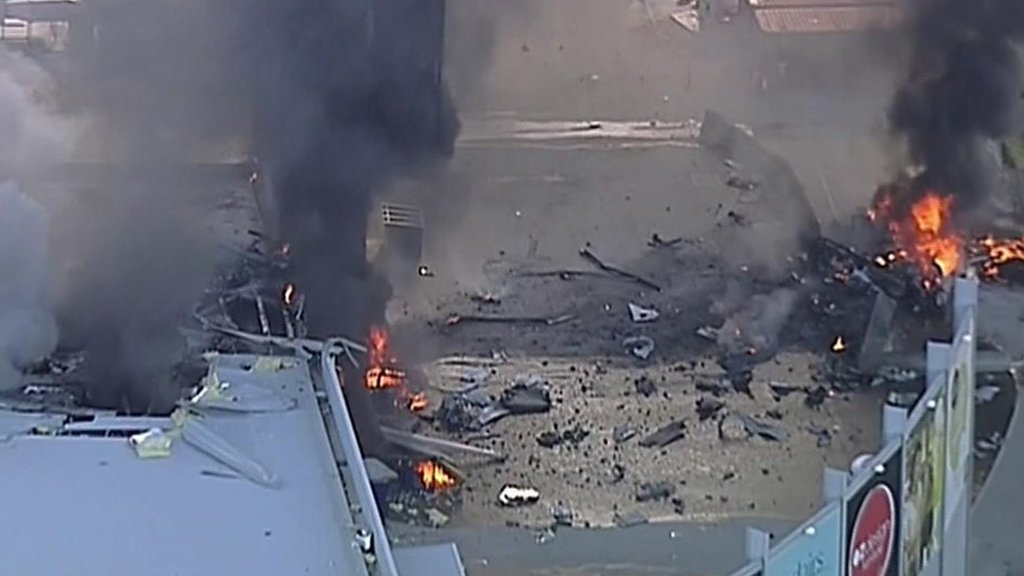 Light plane crashes into Melbourne shopping complex