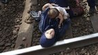 Woman and baby lying on tracks at Hungarian town of Bicske