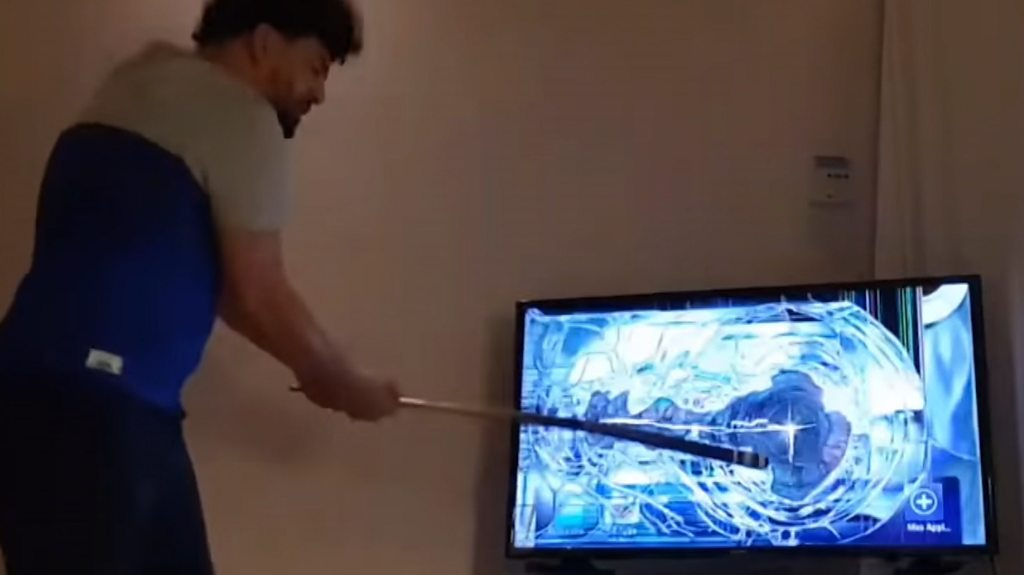Fan smashes his TV when his team loses