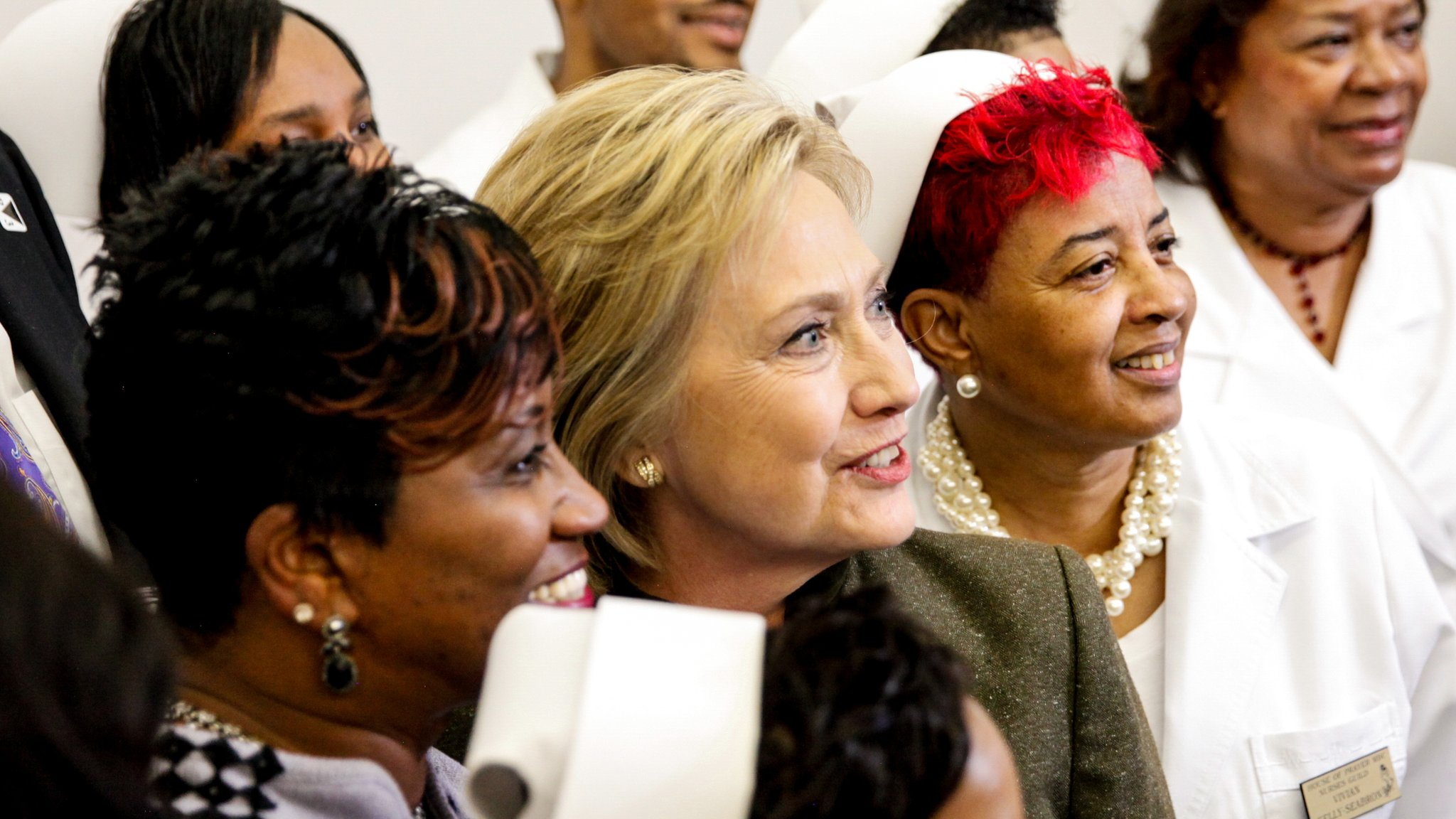 Hillary Clinton with voters in Flint, Michigan