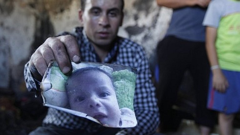 Palestinians react with outrage after an infant is killed in an arson attack blamed on Jewish settlers in a village in the West Bank.