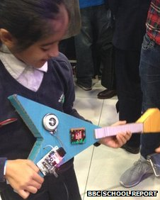 School Reporter trying out a Micro Bit guitar