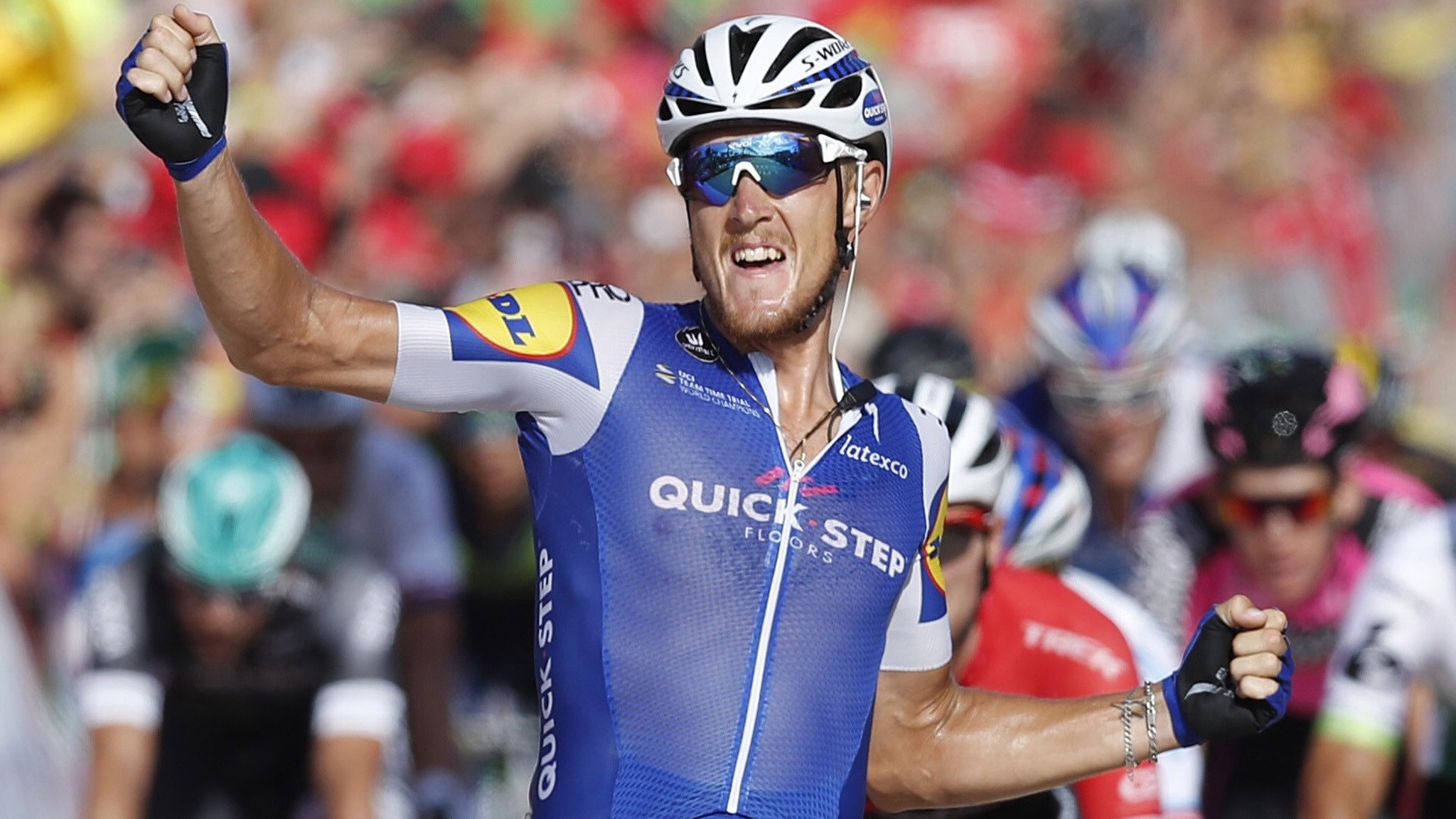 Vuelta a Espana: Matteo Trentin wins stage four as Chris Froome stays in red