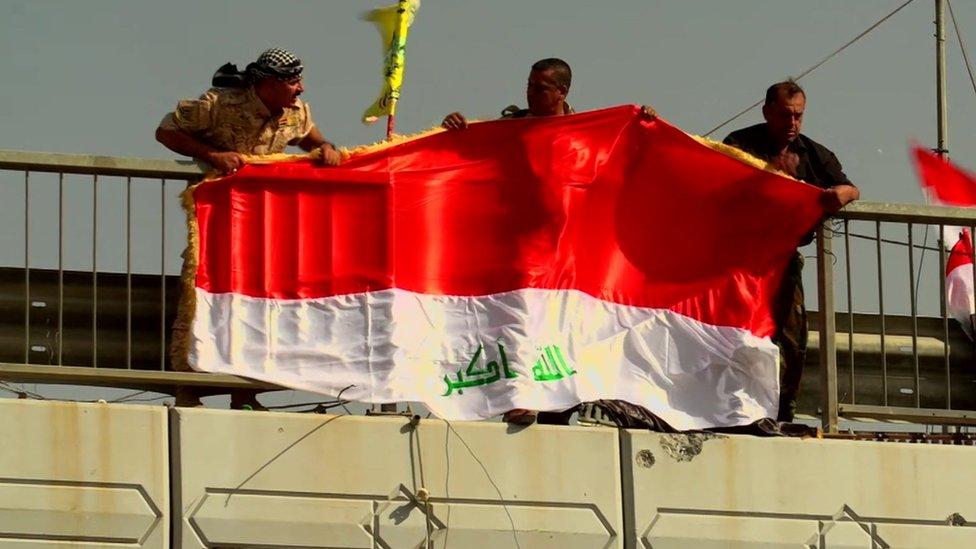 Iraqi 'victory' flag is raised in Falluja
