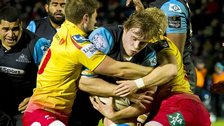 Glasgow's Jonny Gray is held up by the Scarlets defence