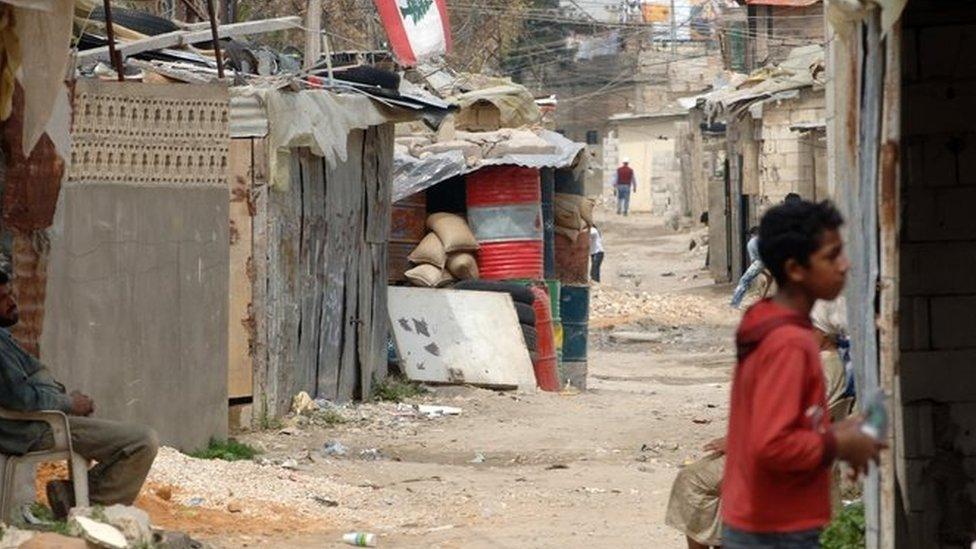 طفل فلسطيني في مخيم عين الحلوة في لبنان
