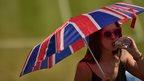 A fan with an umbrella at Wimbledon
