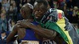 Usain Bolt hugs Mo Farah