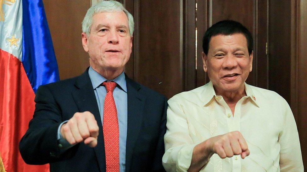 Australian spy chief criticised for Duterte fist photo