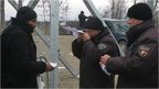Border official check migrant's papers at Greece Macedonia border