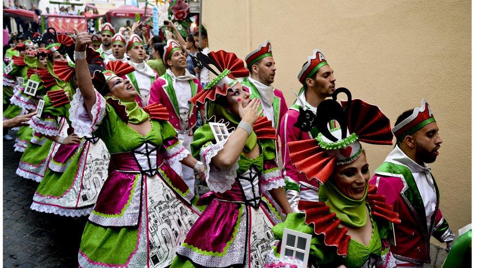 Revellers celebrate the feast of St Anthony, Lisbon's patron saint