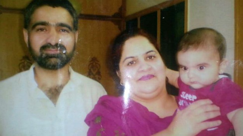 Gulzar Ahmad Tantray with his wife and child in Pakistan-administered Kashmir