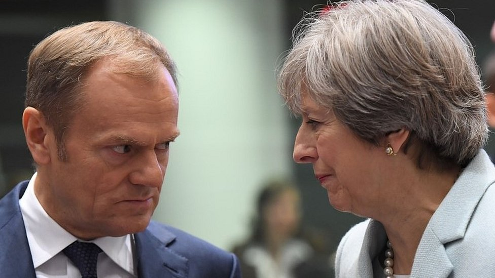 Brexit: May says positive vibe but EU warns of 'huge challenge'