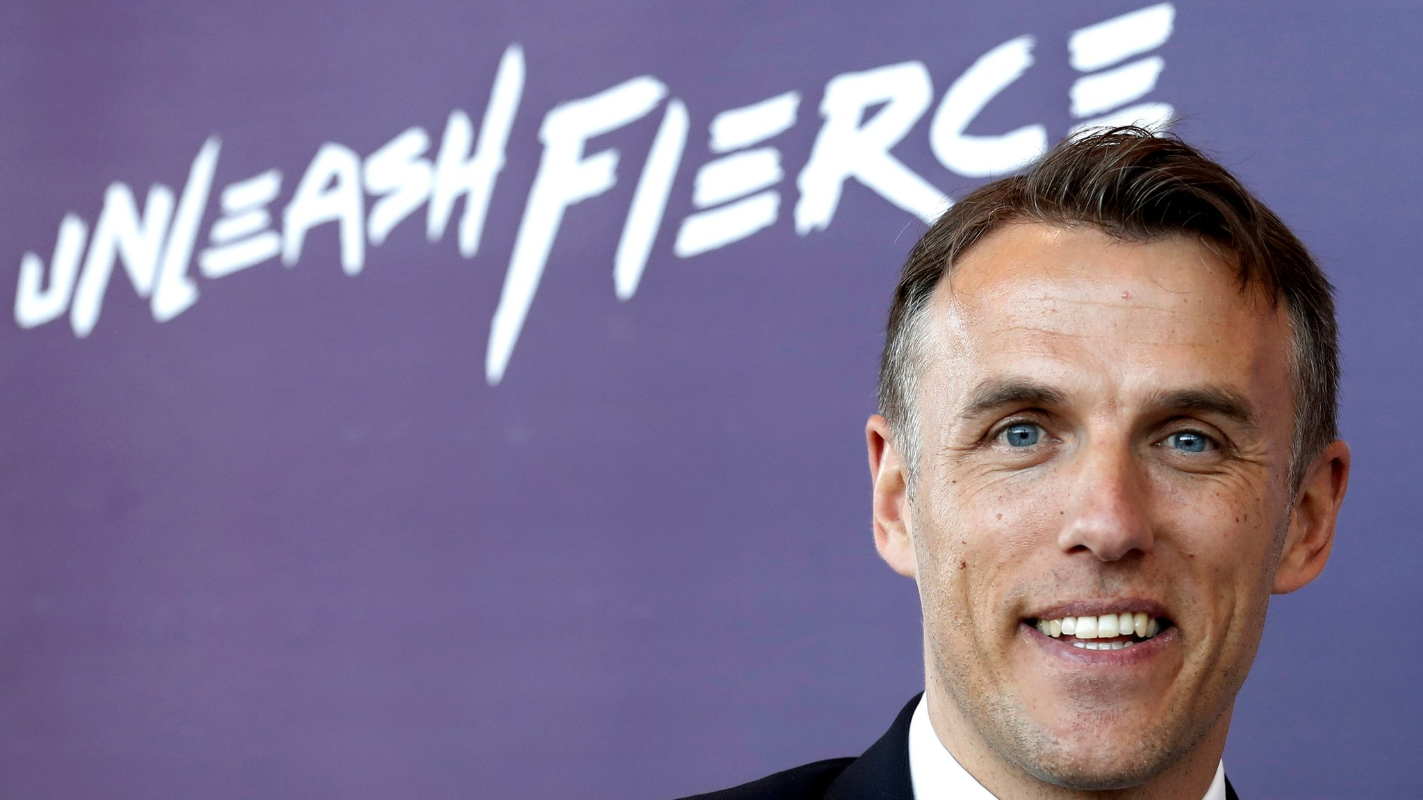 'Neville must turn England from world-class players into winners'