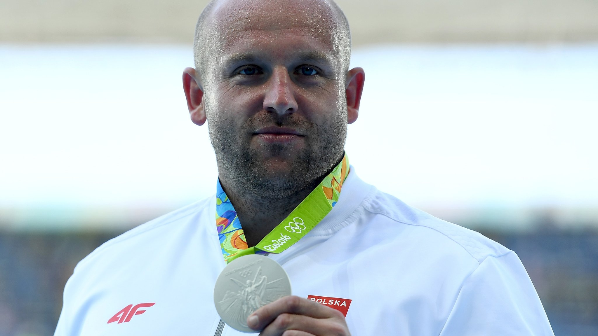 Olympian donates medal to help boy with cancer