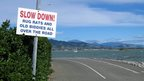 Slow down sign in New Zealand
