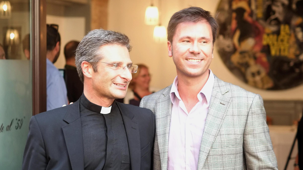 Monsignor Krzysztof Charamsa, second secretary of the Vatican's International Theological Commission, with his partner Eduard leaves after a press conference in Rome, Italy, 03 October 2015