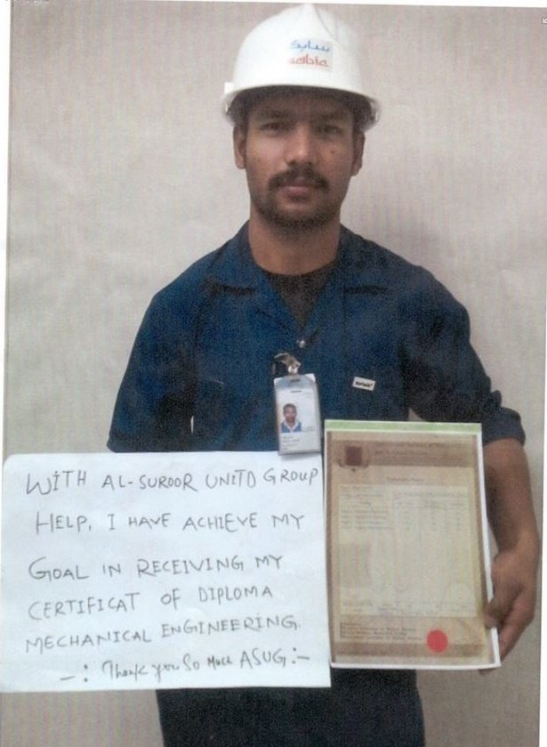 This migrant worker's sign thanks the company for helping him receive a mechanical engineering qualification.