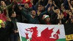 Wales fans cheer their team on during the Euro 2016 qualifier on Saturday