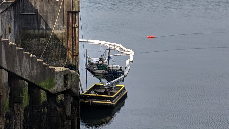 Anti-pollution booms deployed as fishing boat sinks at Oban
