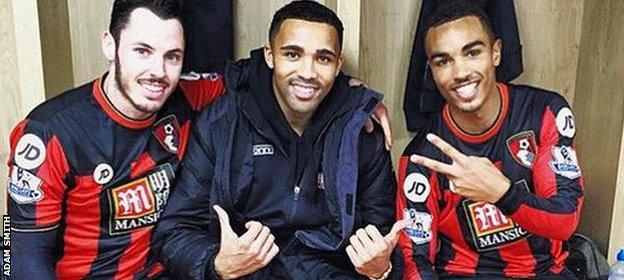 Adam Smith celebrates beating Manchester United with Bournemouth team-mates Callum Smith and Junior Stanislas