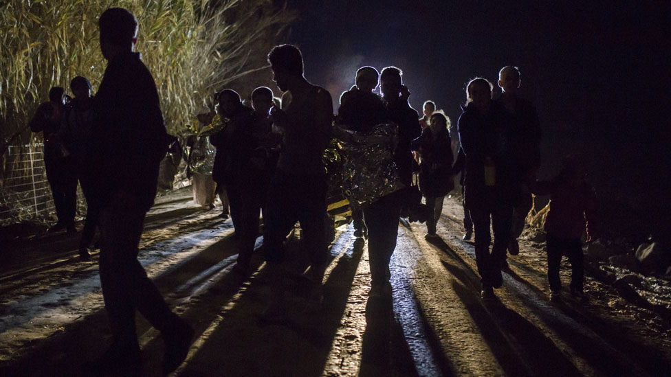 Migrants arrive in Greece after crossing the sea on a dinghy