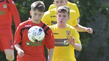 Antrim's Marc McKenna battles with Londonderry's Jack Malone at Anderson Park in Coleraine