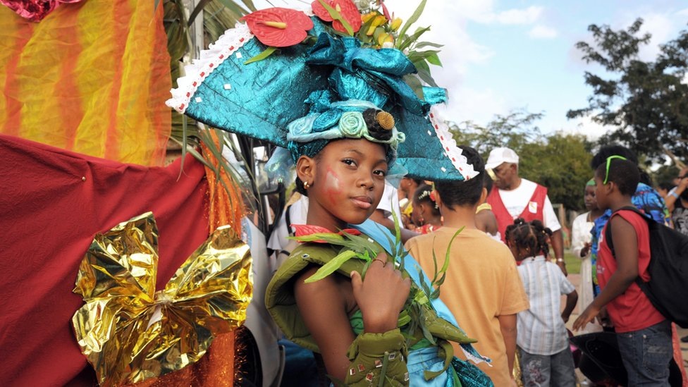 "'Mini queen of Martinique"" poses during carnival parade in Fort-de-France"