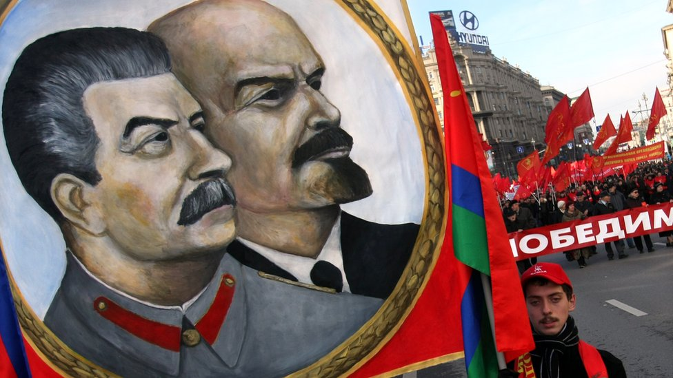 Lenin and Stalin share a banner at a pro-Communist party rally in Moscow