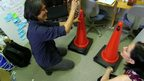 Prof Yasushi Matoba sets up a traffic cone with a built-in fan