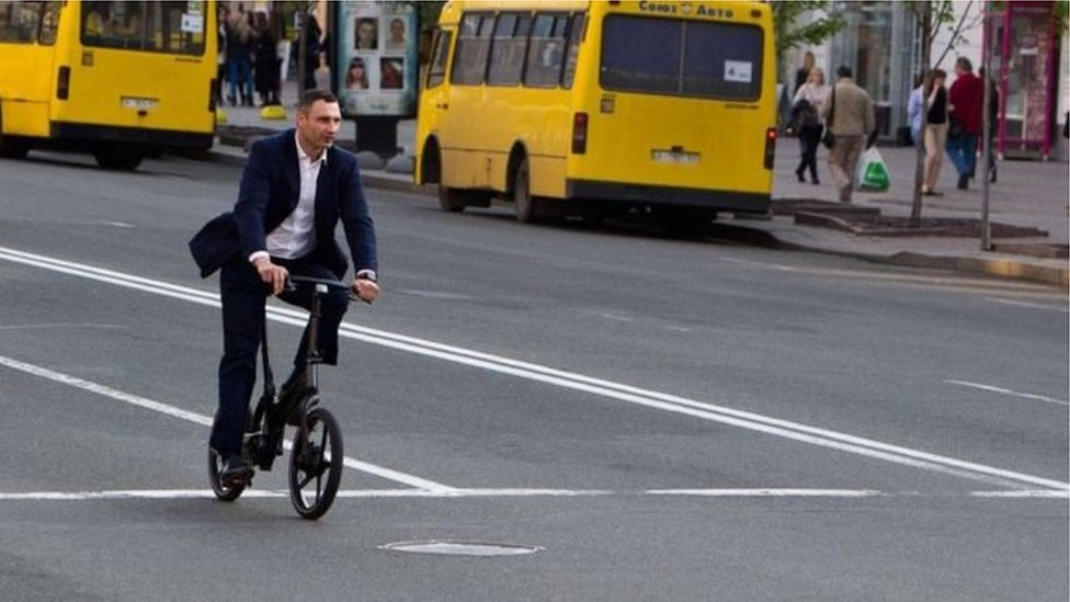 Vitaliy Klitschko's riding a bike.