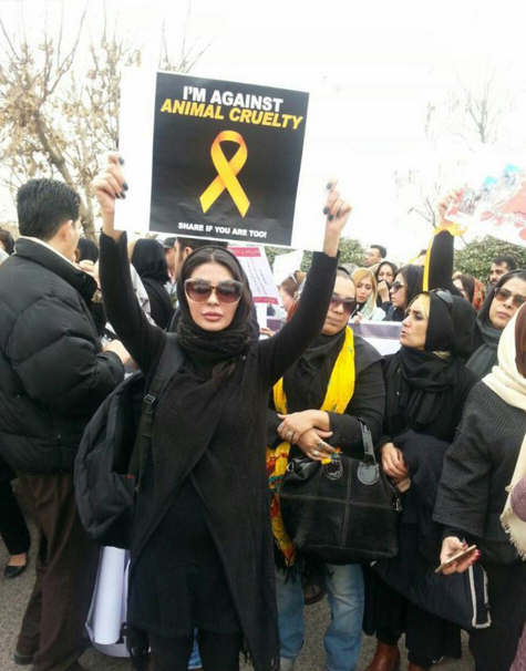 A woman holding up a placard
