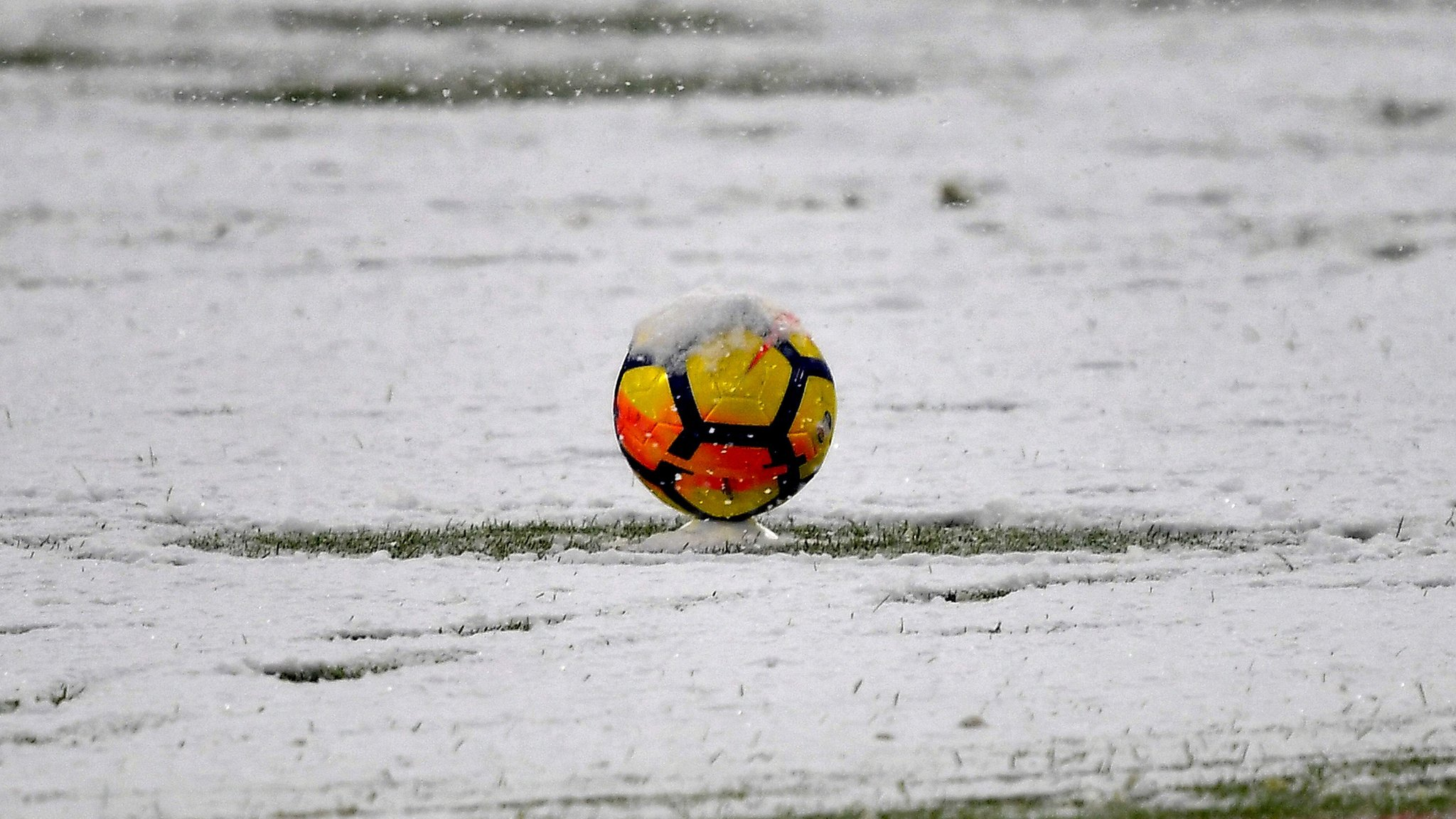 Snow causes postponements in football, rugby union and racing across UK