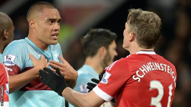 Manchester United midfielder Bastian Schweinsteiger (right) clashed with West Ham defender Winston Reid