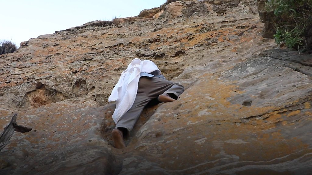 Ethiopian cliff church gives priest daily test of faith