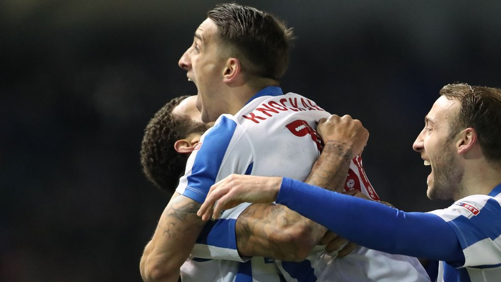 Three red cards & three goals as Brighton go top