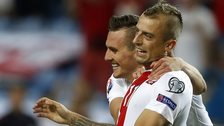 Poland's Kamil Grosicki and Arkadiusz Milik celebrate