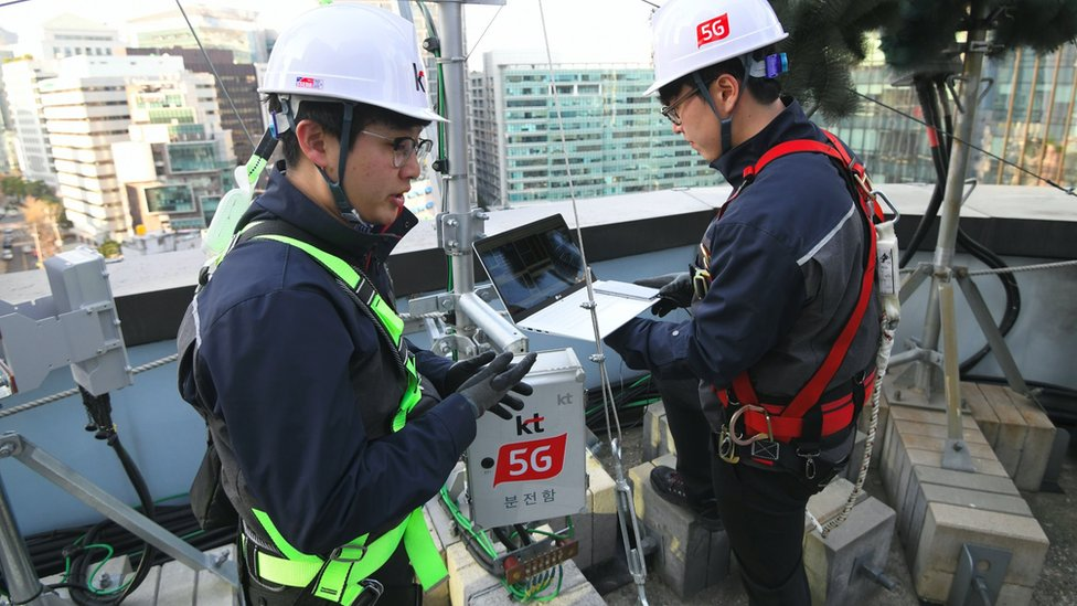 Engineers check a 5G mast in Seoul, South Korea, where the technology has been available for 18 months