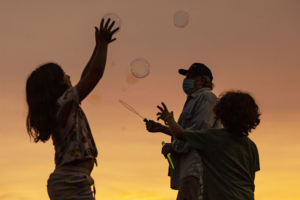 A man makes soap bubbles on California's Venice Beach