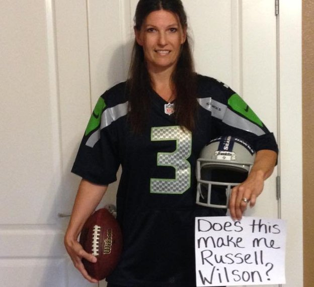 A woman dressed as an American football player with a message reading 'does this make me Russell Wilson?'