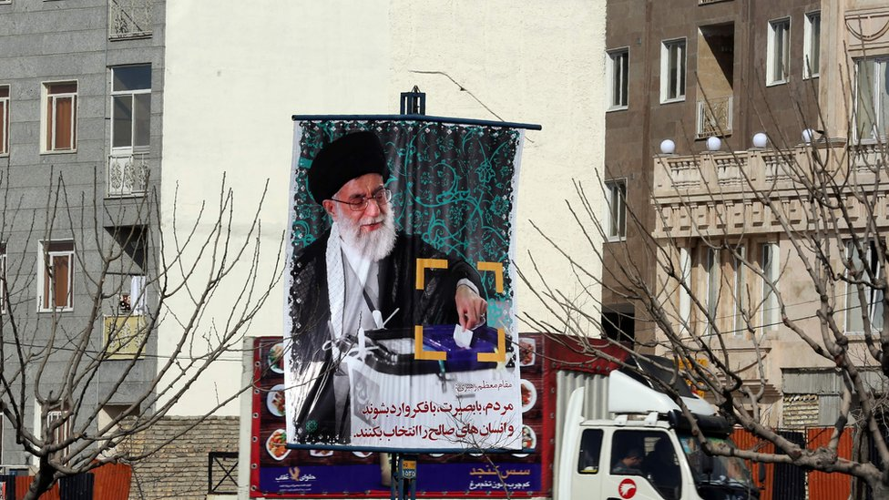 Banner depicting a portrait of Iran's Supreme Leader Ayatollah Ali Khamenei as part of a campaign to encourage people to take part in elections.