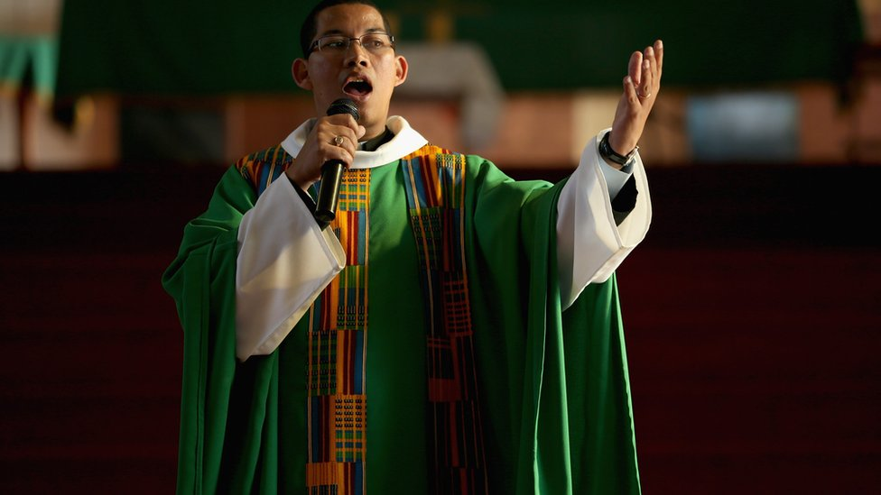 South African priest delivering sermon