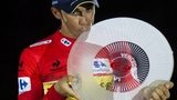 Tinkoff's Spanish cyclist Alberto Contador kisses the trophy on the podium after winning the 69th edition of La Vuelta
