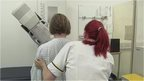 Nurse helping patient during mammogram