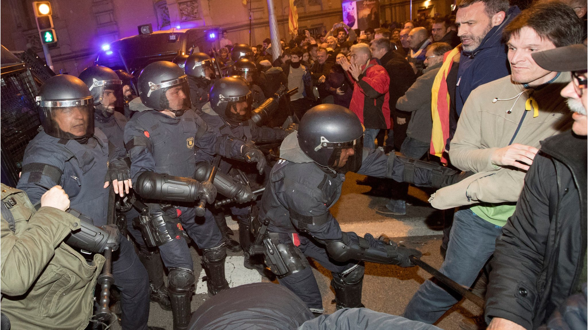 Spain Catalonia: Clashes after separatist leaders detained