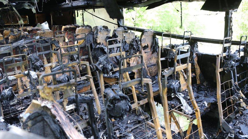 Coach carrying 25 schoolchildren catches fire