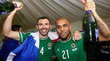 Gareth McAuley and Josh Magennis celebrate after sealing Euro 2016 qualification